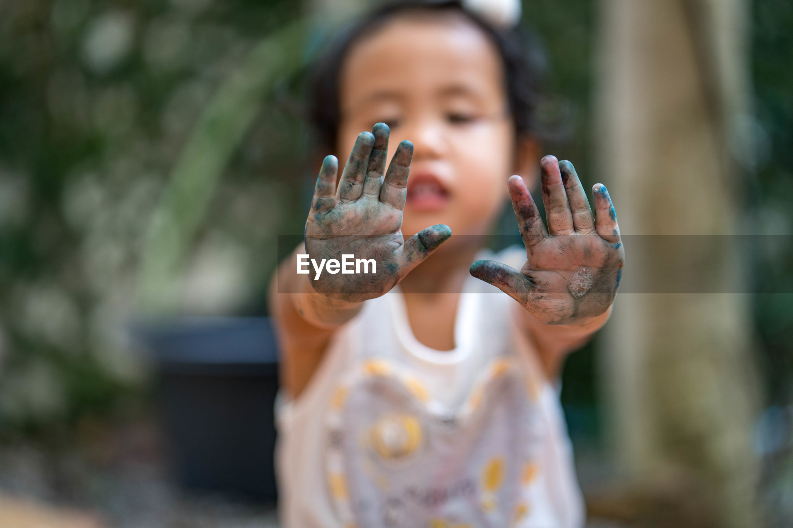 Close-up of girl showing messy hands