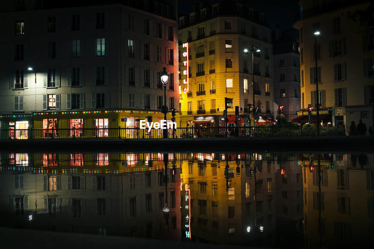 architecture, building exterior, built structure, reflection, night, water, building, city, waterfront, illuminated, residential building, no people, outdoors, residential