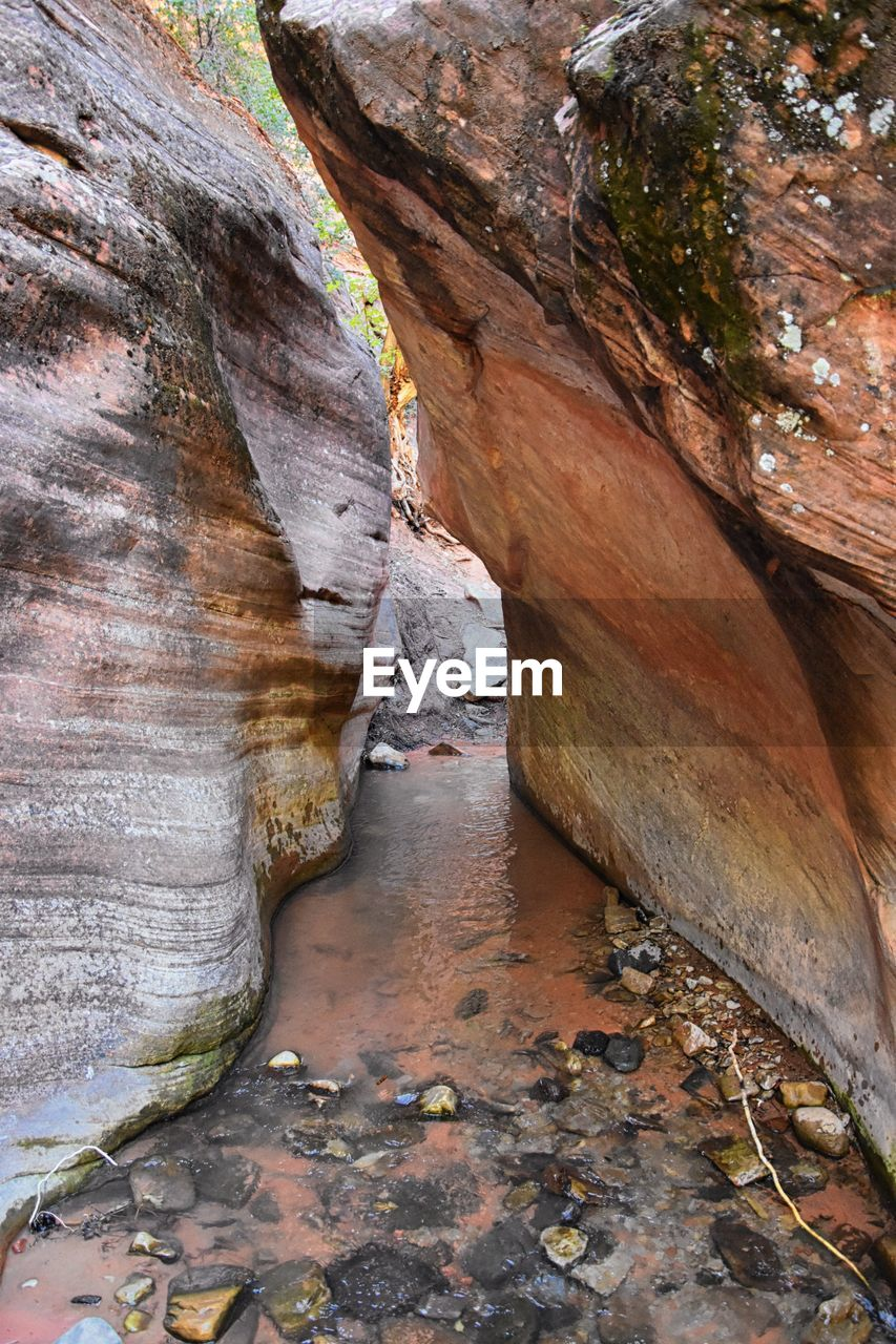 rock, rock - object, solid, rock formation, day, no people, geology, nature, physical geography, beauty in nature, tranquility, non-urban scene, textured, outdoors, land, rough, pattern, brown, travel destinations, scenics - nature, eroded, sandstone, formation, flowing water