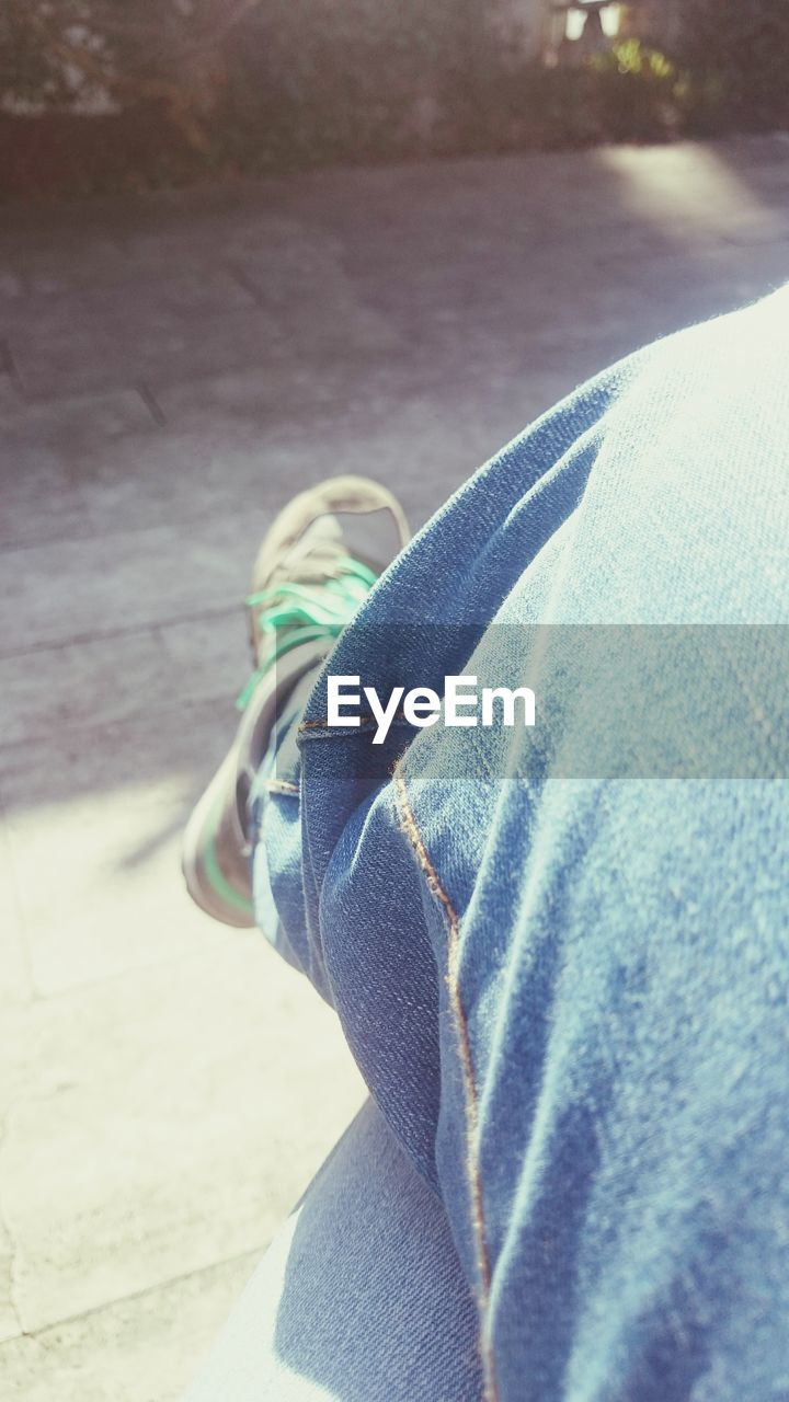 low section, human leg, one person, jeans, day, human body part, close-up, casual clothing, trousers, real people, outdoors, men, nature, people