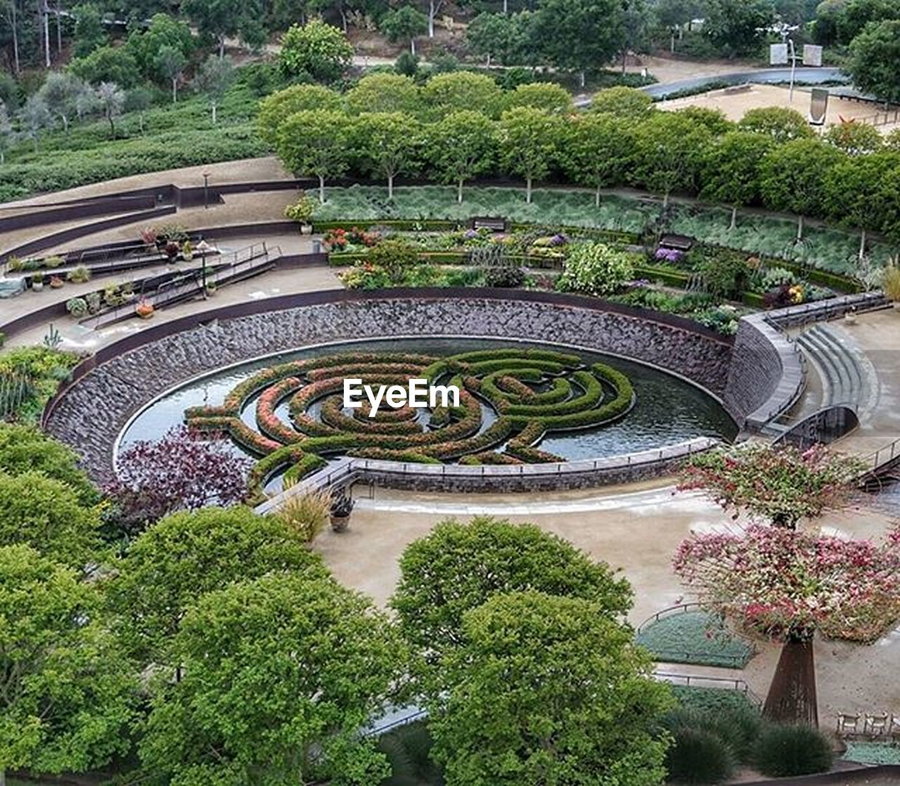plant, tree, high angle view, growth, green color, topiary, day, nature, outdoors, water, built structure, no people, architecture, botanical garden, grass, beauty in nature, greenhouse