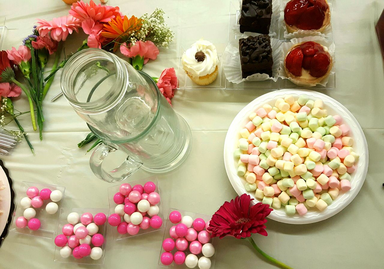 Marshmallow with candies and pastry on table