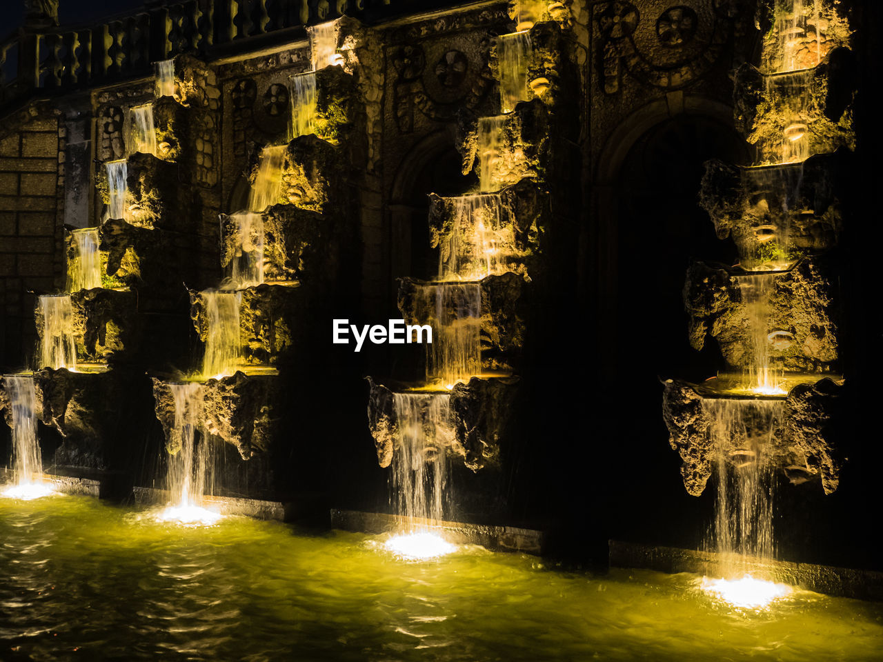 water, illuminated, spirituality, religion, place of worship, no people, night, waterfront, motion, statue, travel destinations, gold colored, sculpture, architecture, outdoors, close-up