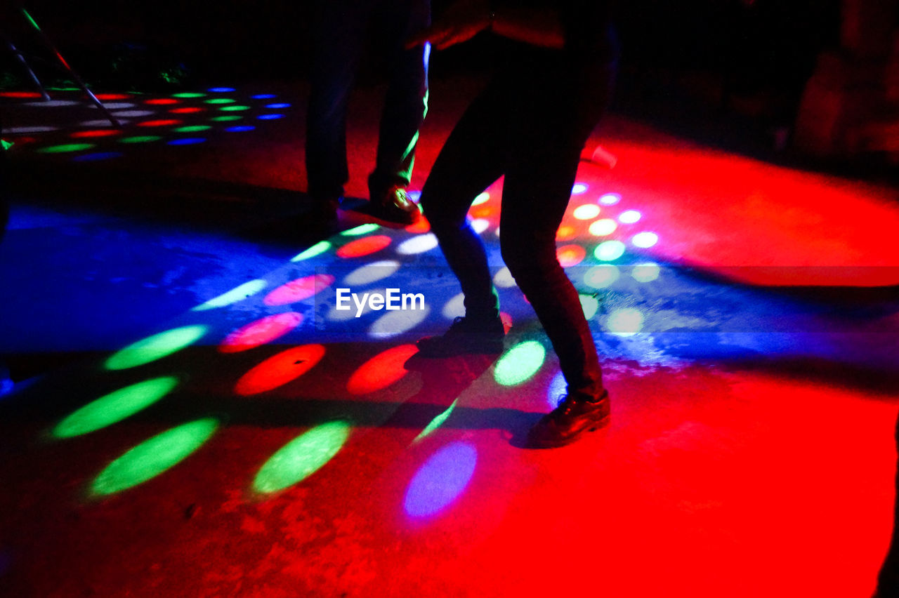 Low section of people dancing in nightclub