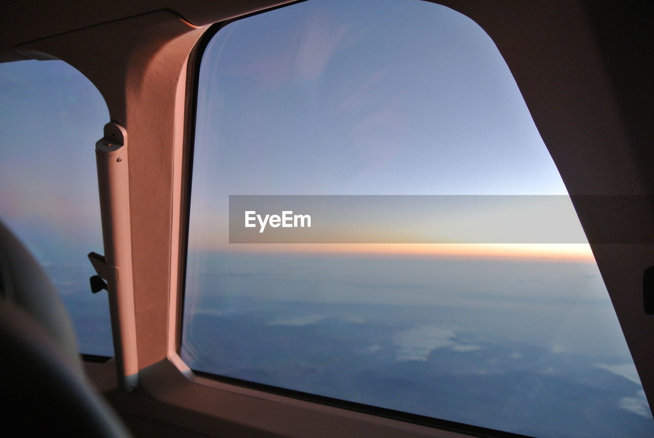 Close-up of airplane interior against sky during sunset
