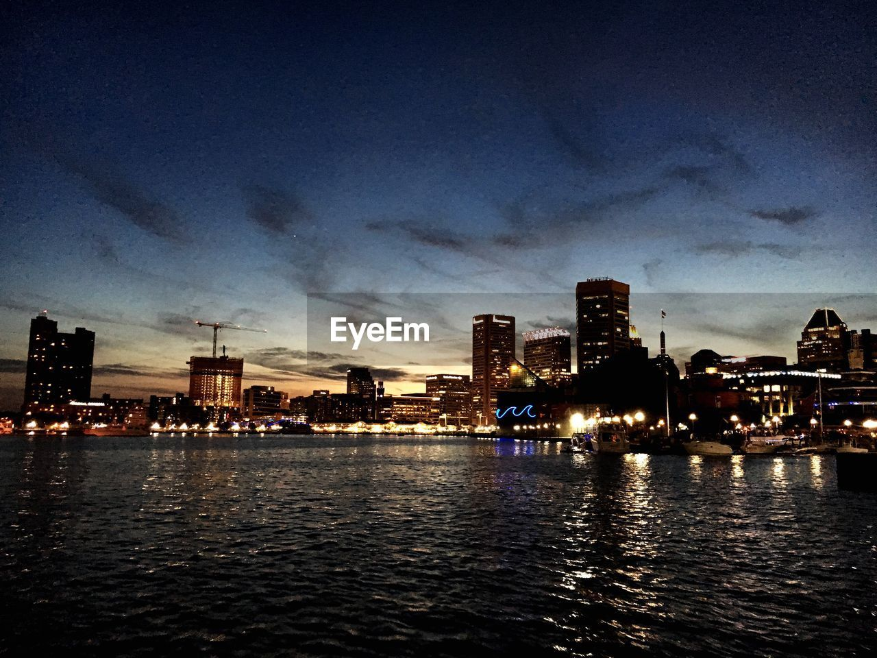 building exterior, architecture, built structure, city, sky, illuminated, skyscraper, cloud - sky, waterfront, night, cityscape, travel destinations, city life, river, water, skyline, urban skyline, no people, outdoors, modern, tall