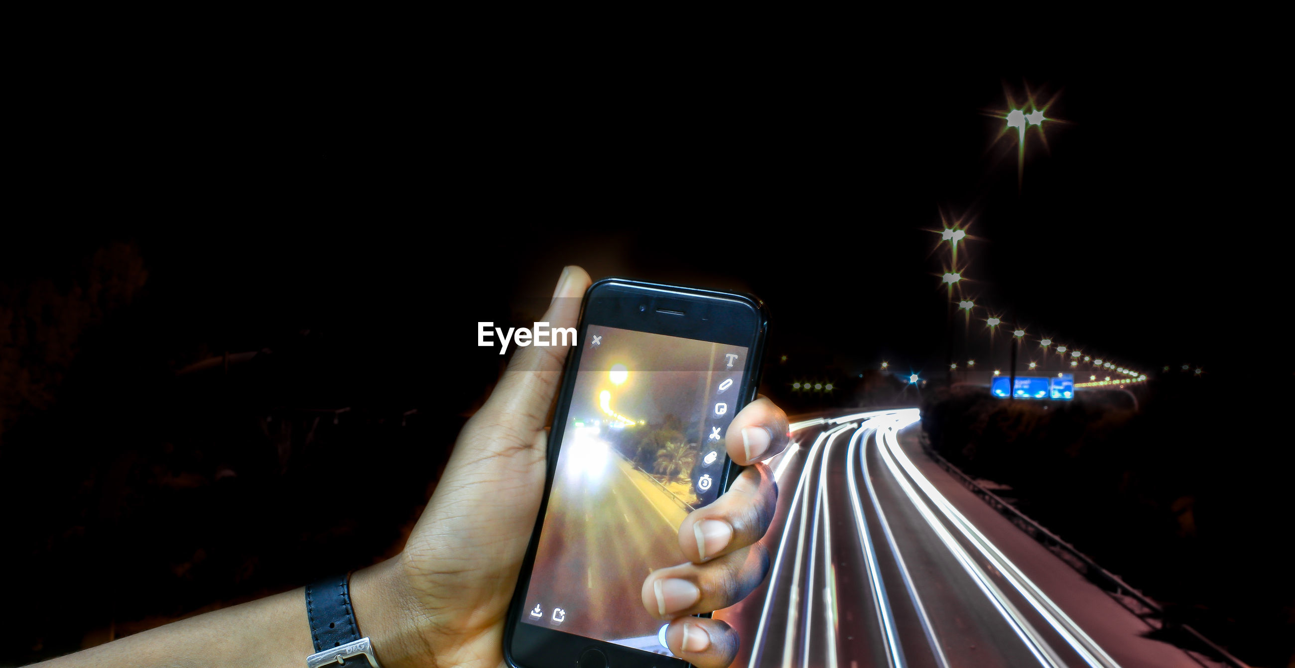 CLOSE-UP OF PERSON PHOTOGRAPHING ILLUMINATED SMART PHONE AT NIGHT