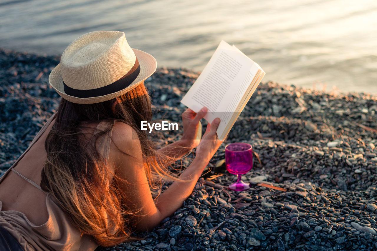 Woman Wearing Hat On Beach