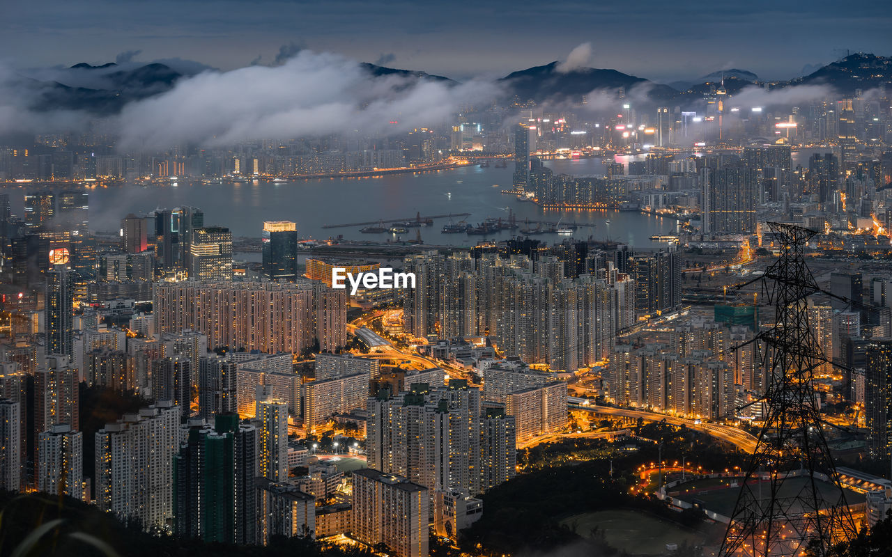 building exterior, architecture, city, cityscape, built structure, cloud - sky, building, sky, illuminated, nature, no people, high angle view, skyscraper, office building exterior, outdoors, night, residential district, glowing, modern, pollution