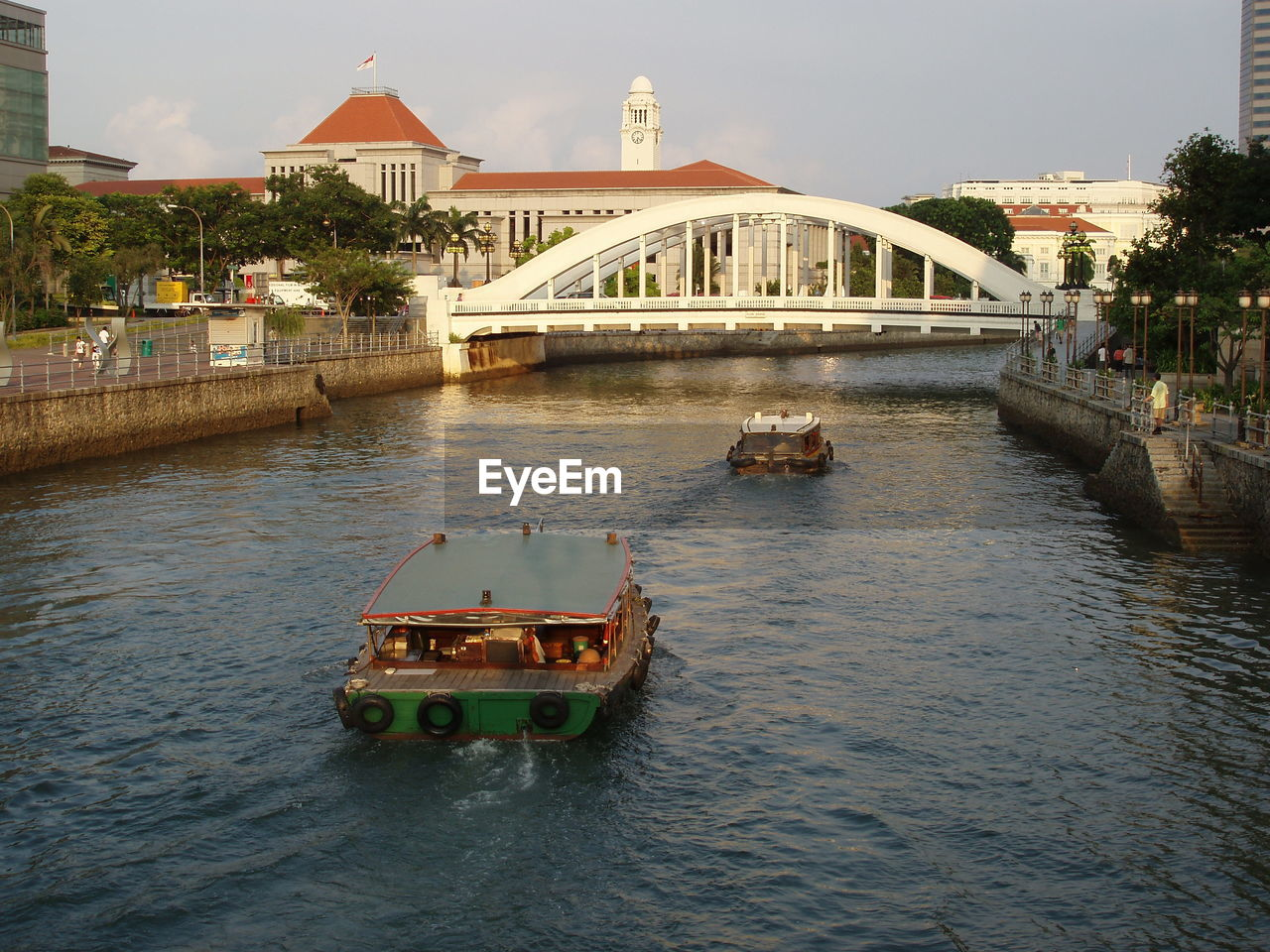architecture, built structure, water, transportation, bridge - man made structure, nautical vessel, mode of transport, river, waterfront, connection, building exterior, outdoors, day, sky, sailing, tree, nature, no people, city