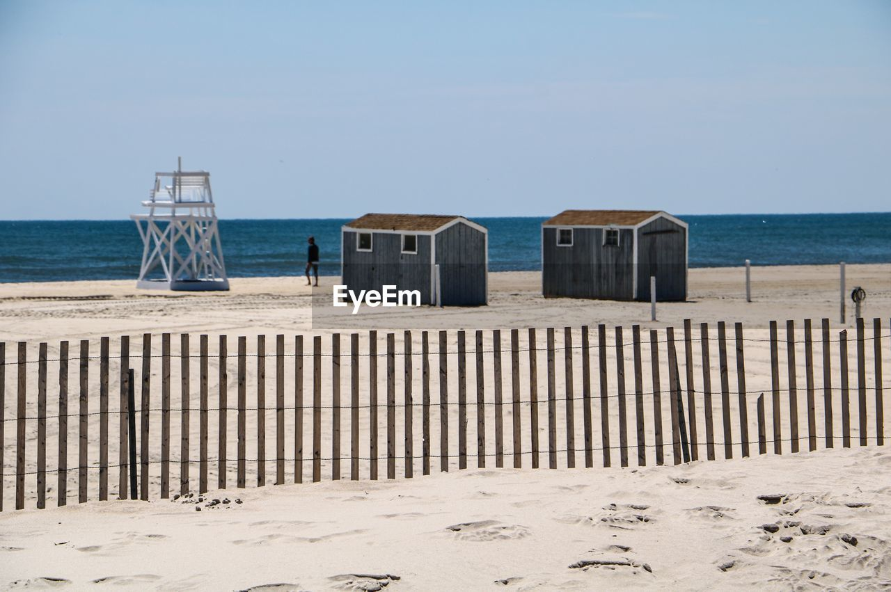water, sea, sky, sand, beach, land, horizon, horizon over water, nature, day, scenics - nature, beauty in nature, hooded beach chair, tranquility, clear sky, tranquil scene, architecture, sunlight, no people, outdoors, wooden post