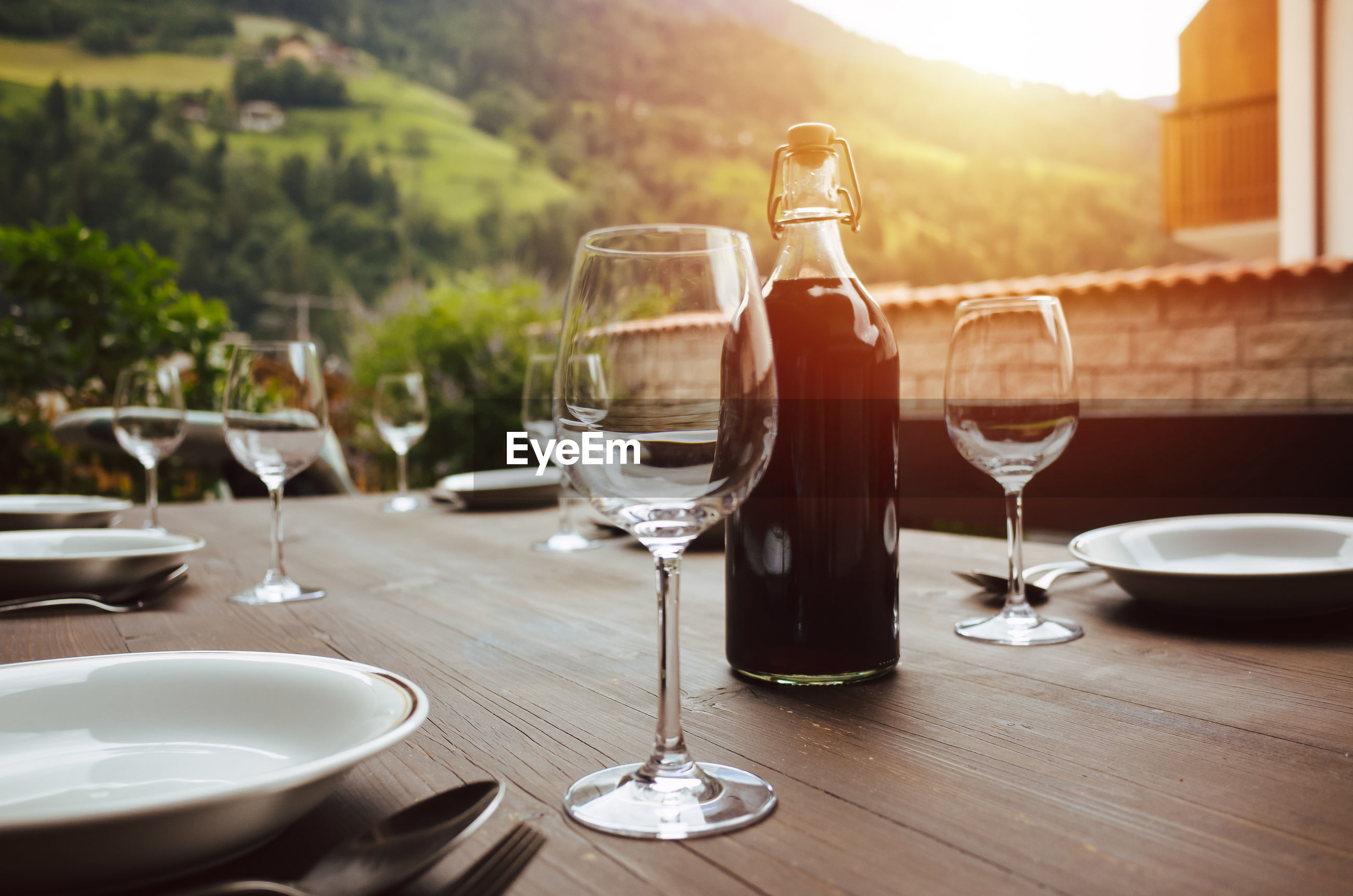 Wineglasses on table outdoors