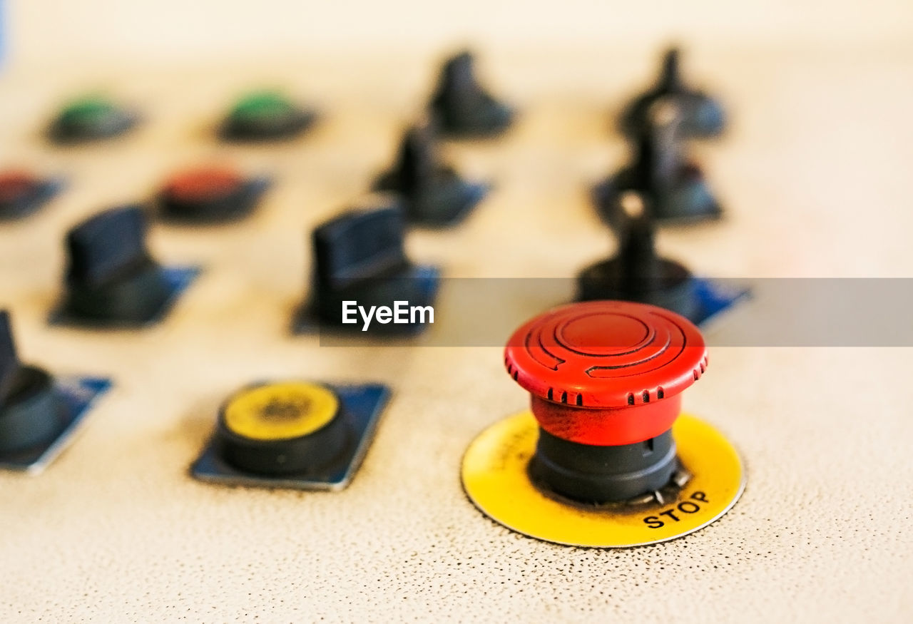 indoors, table, still life, close-up, focus on foreground, no people, relaxation, control, plastic, yellow, arts culture and entertainment, wood - material, selective focus, metal, leisure games, toy, red, blue, leisure activity, shape