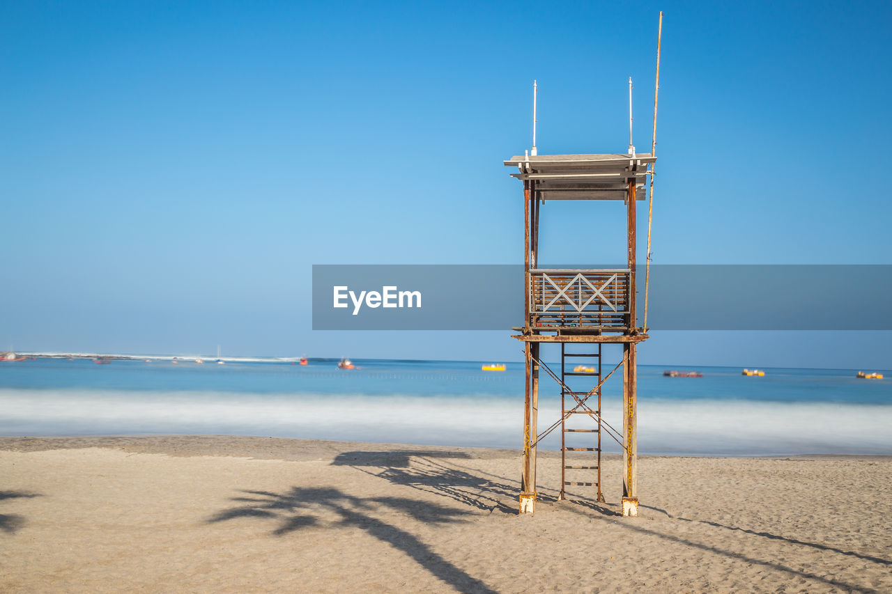 Lookout Tower At Beach Against Clear Blue Sky