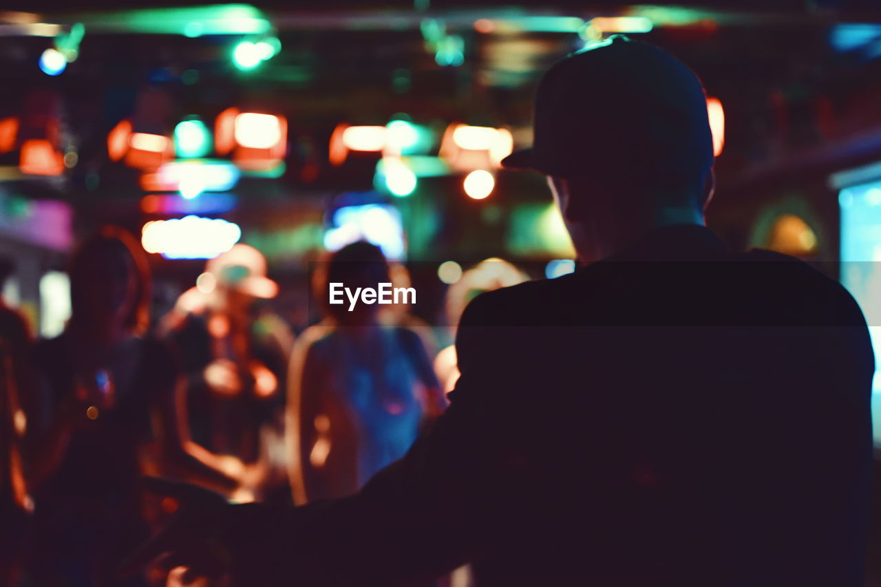 Rear View Of Man At Nightclub