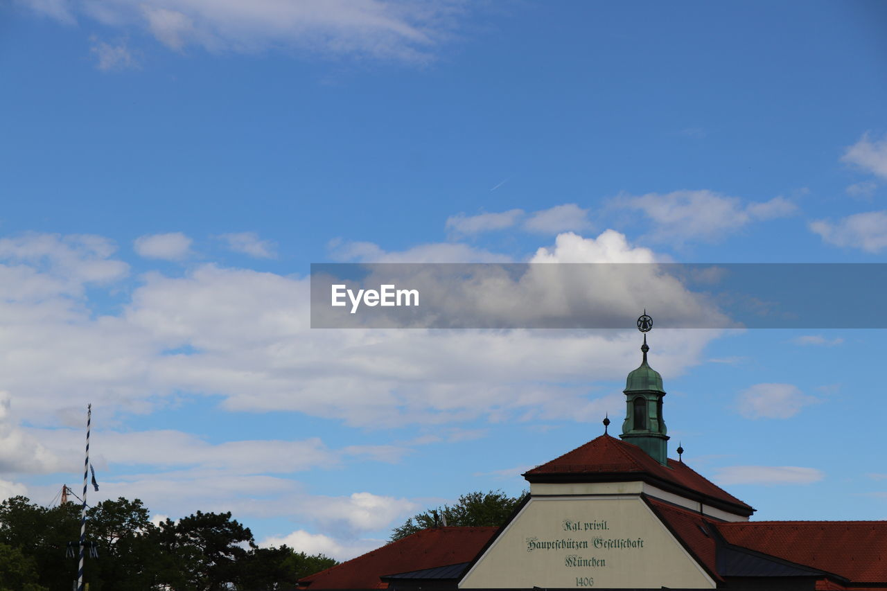 cloud - sky, sky, low angle view, architecture, built structure, day, religion, no people, building exterior, weather vane, guidance, outdoors, communication, spirituality, roof, statue