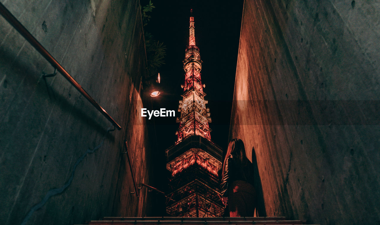 architecture, built structure, illuminated, building, night, low angle view, no people, building exterior, wall - building feature, lighting equipment, outdoors, place of worship, staircase, belief, religion, direction, architectural column, steps and staircases, the way forward