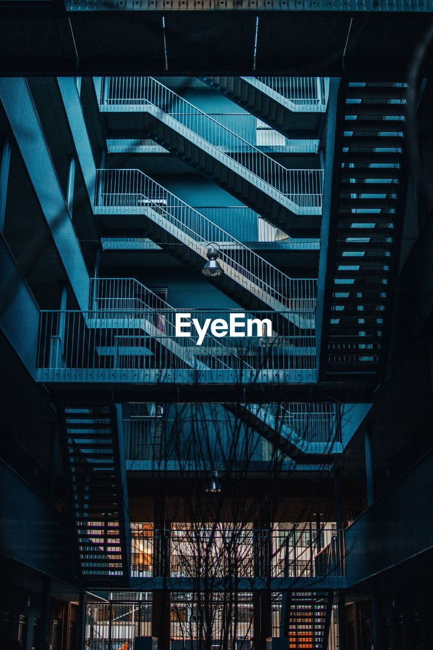 architecture, built structure, building exterior, modern, low angle view, building, no people, city, night, illuminated, connection, outdoors, nature, steps and staircases, glass - material, sky, railing, pattern, dusk, ceiling, office building exterior, steel