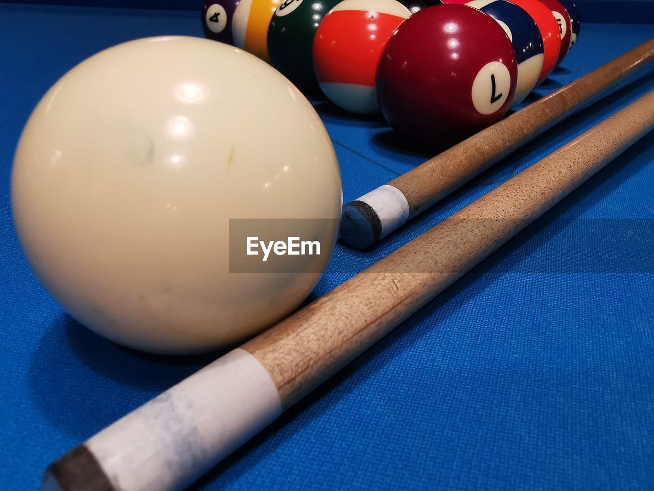 sport, ball, table, pool ball, still life, sphere, blue, pool table, pool cue, pool - cue sport, indoors, no people, close-up, sports equipment, snooker, high angle view, leisure games, cue ball, relaxation, arts culture and entertainment