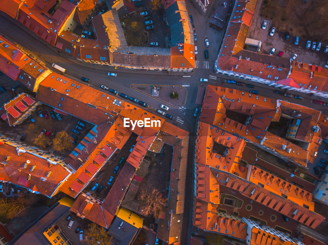 architecture, building exterior, high angle view, built structure, city, no people, roof, aerial view, transportation, illuminated, night, cityscape, road, outdoors, building, residential district, full frame, orange color, mode of transportation, street
