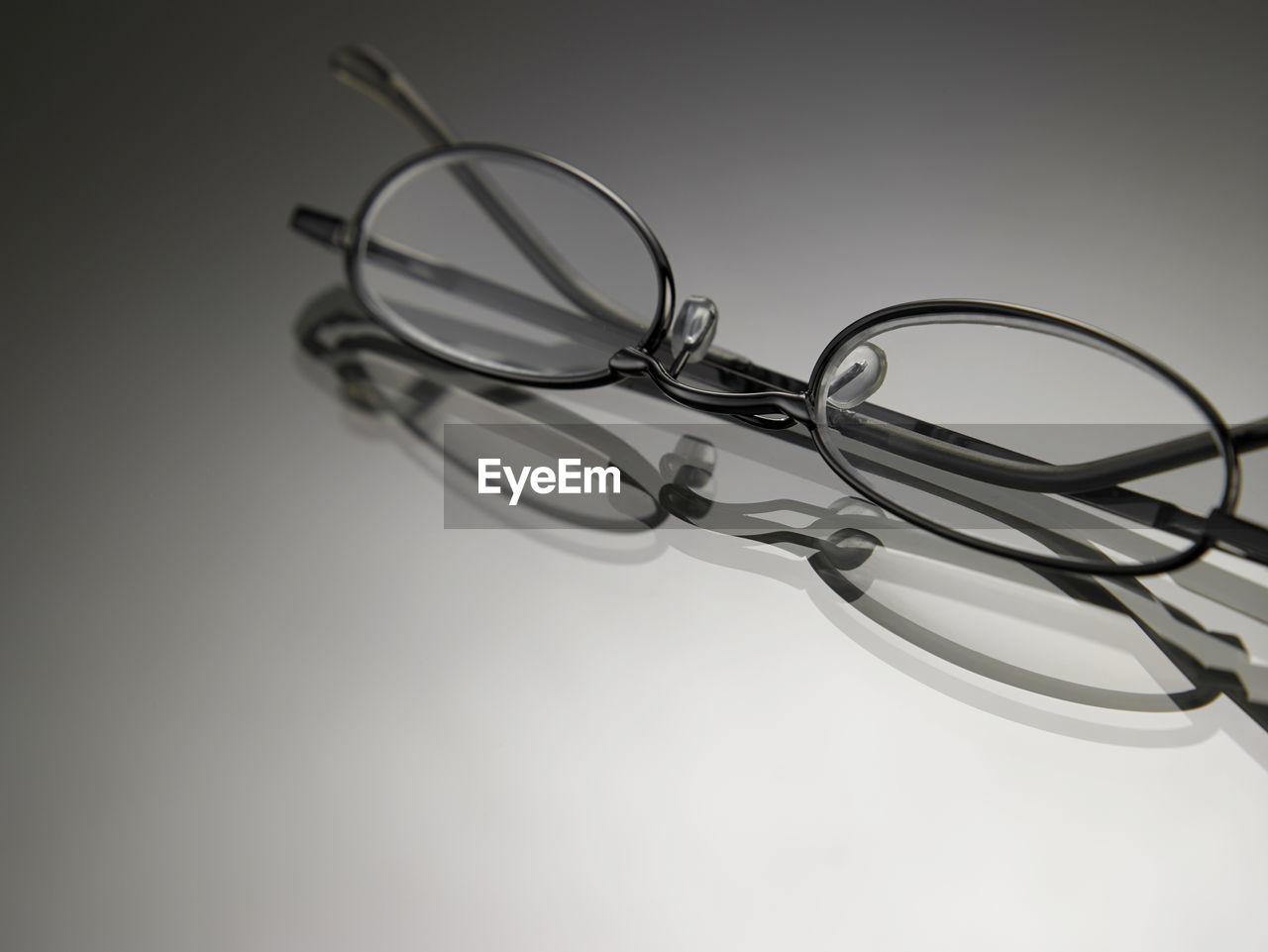 Close-Up Of Eyeglasses On Gray Background