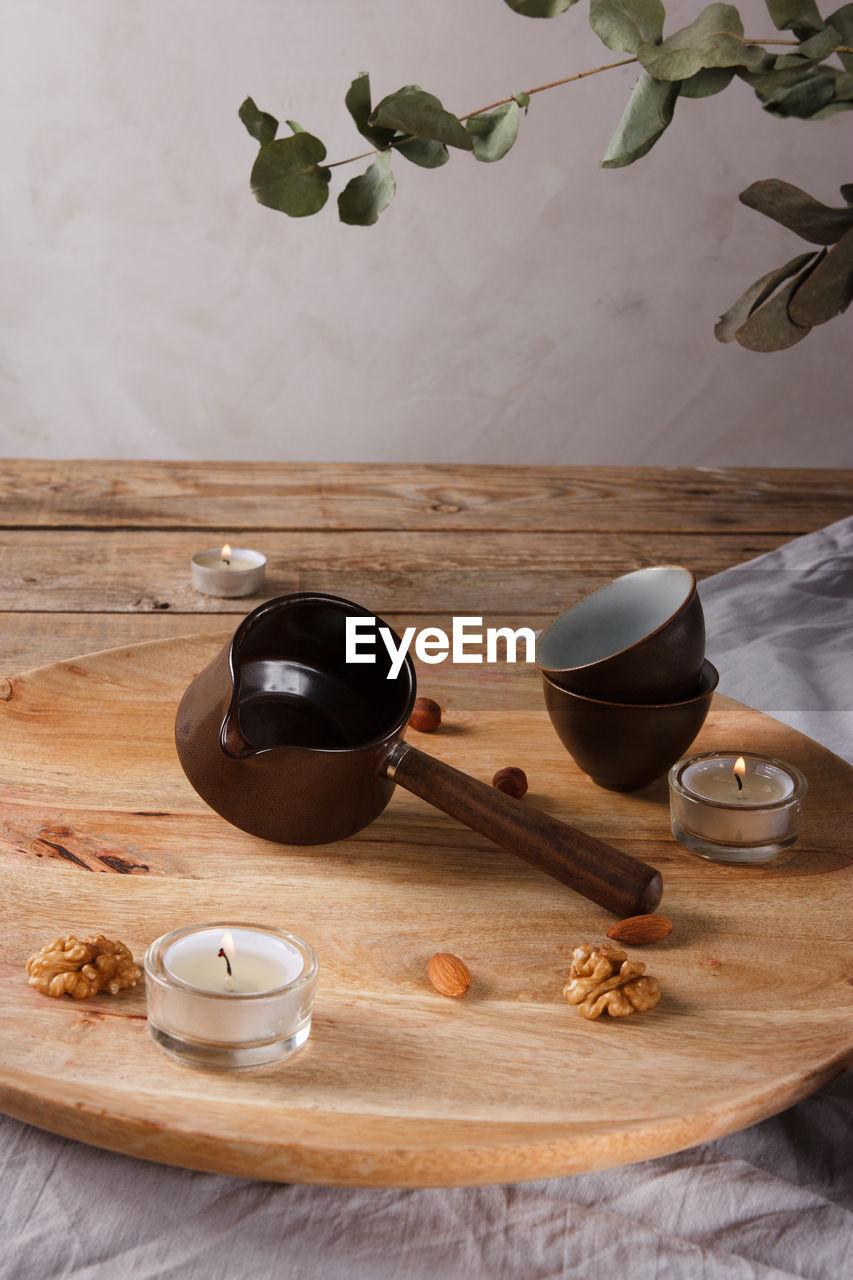 HIGH ANGLE VIEW OF TEA AND WINE ON TABLE