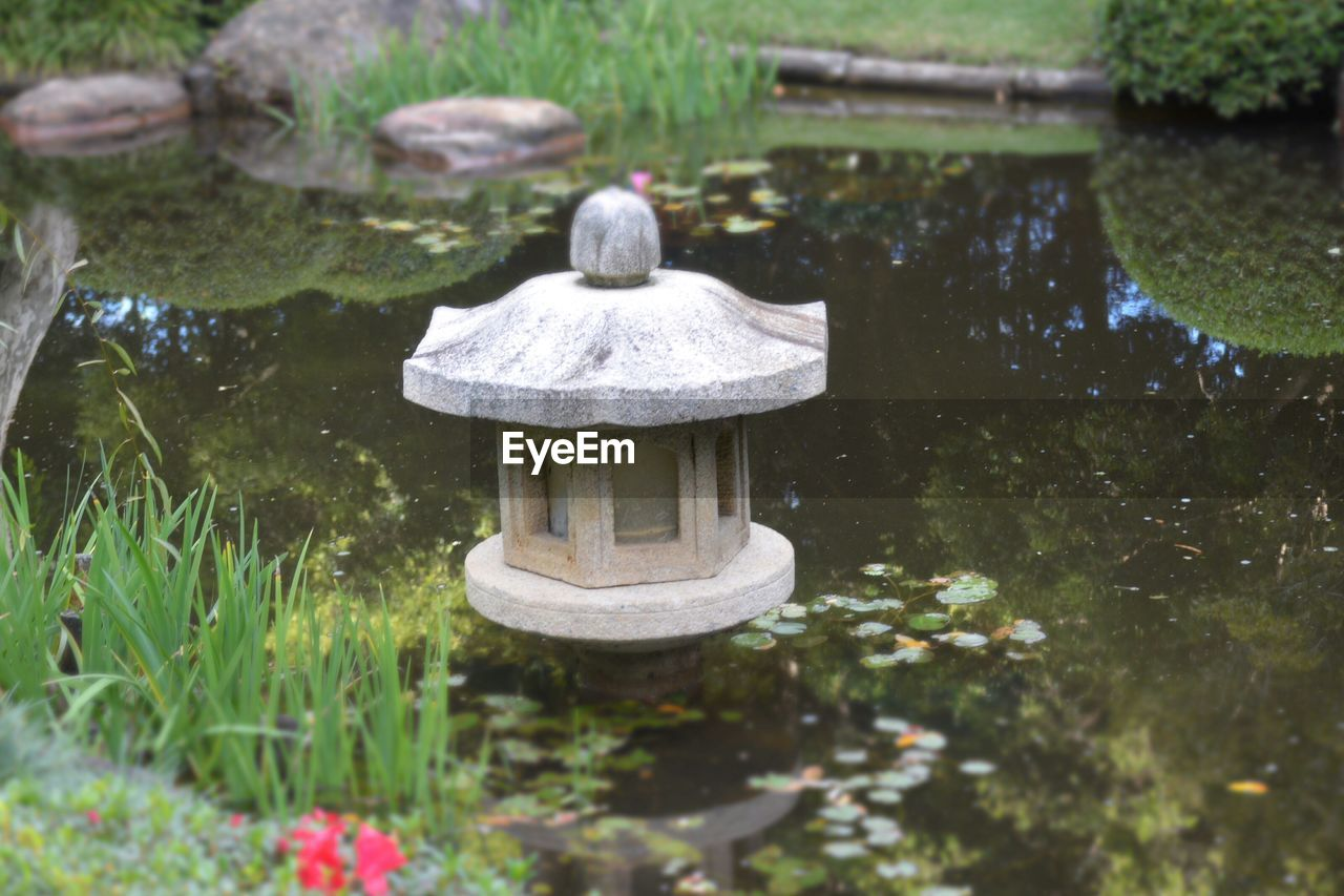 Japanese lantern in pond