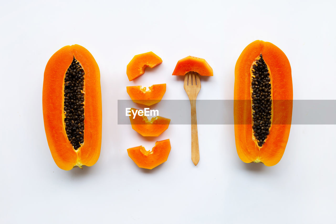 food and drink, food, orange color, white background, studio shot, healthy eating, wellbeing, freshness, still life, vegetable, carrot, indoors, no people, root vegetable, close-up, raw food, slice, group of objects, fruit, cut out, orange, chopped