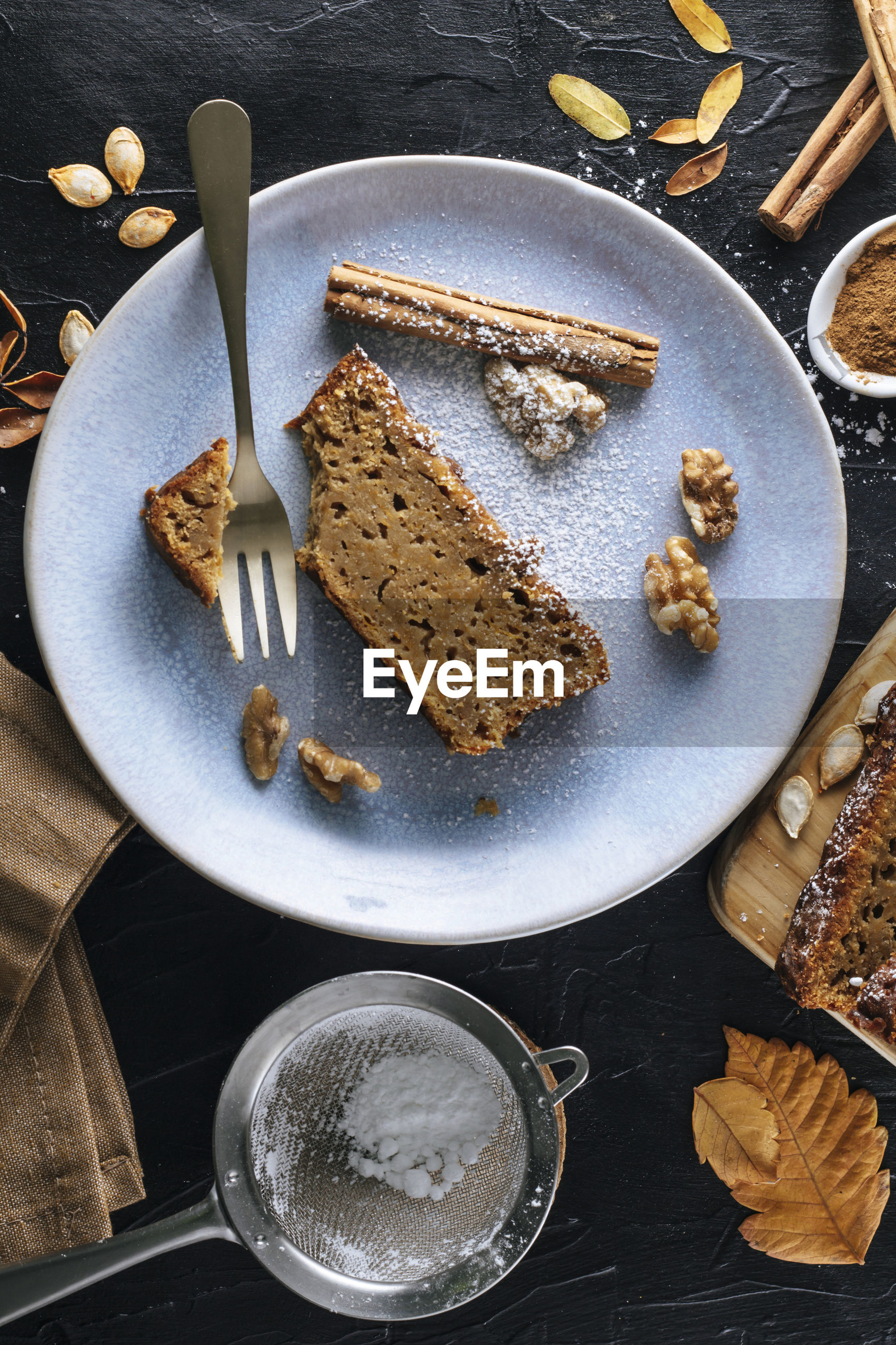 HIGH ANGLE VIEW OF CAKE SLICE IN PLATE