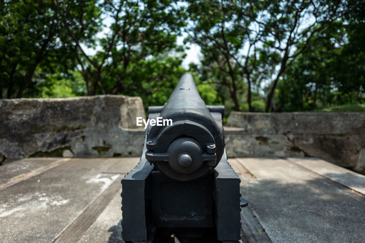 day, tree, nature, no people, architecture, focus on foreground, cannon, plant, weapon, close-up, history, metal, the past, outdoors, sunlight, security, conflict, fighting, military, war, stone wall