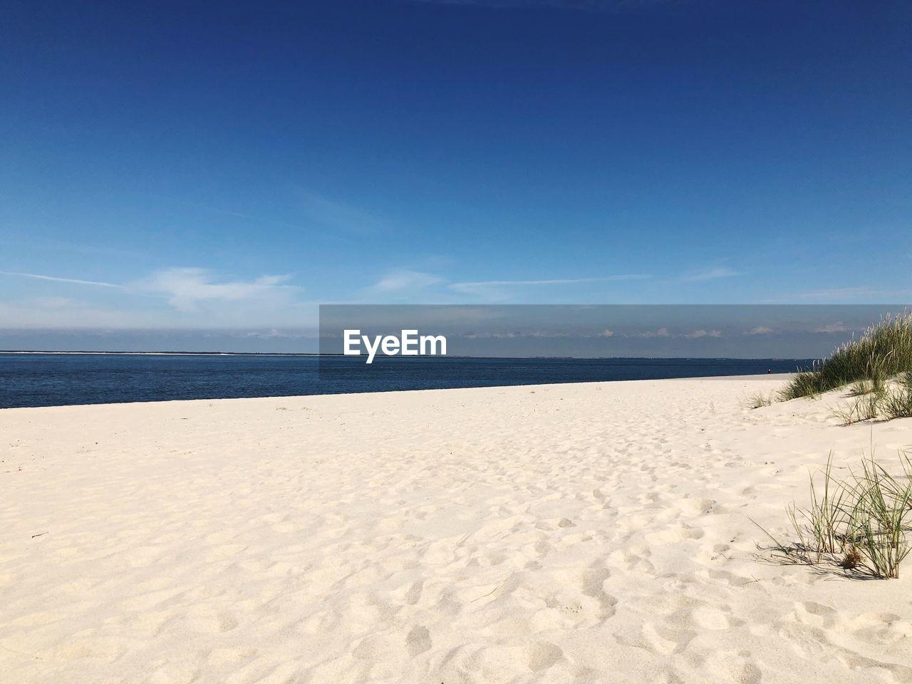 sky, land, beach, sand, tranquility, beauty in nature, scenics - nature, tranquil scene, horizon, sea, horizon over water, nature, blue, day, no people, water, non-urban scene, cloud - sky, idyllic, marram grass