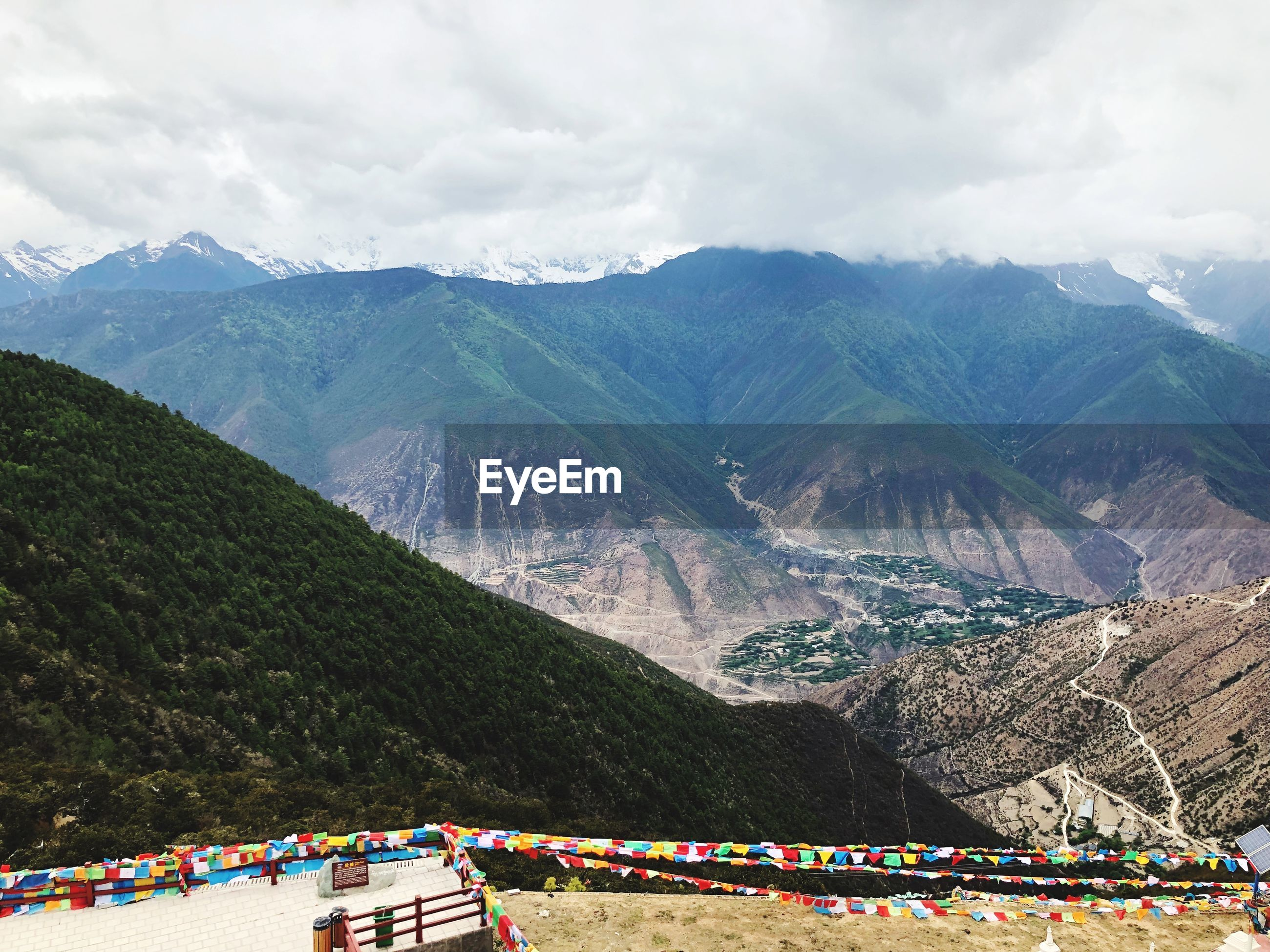 Prayer flags hanging against mountains during winter