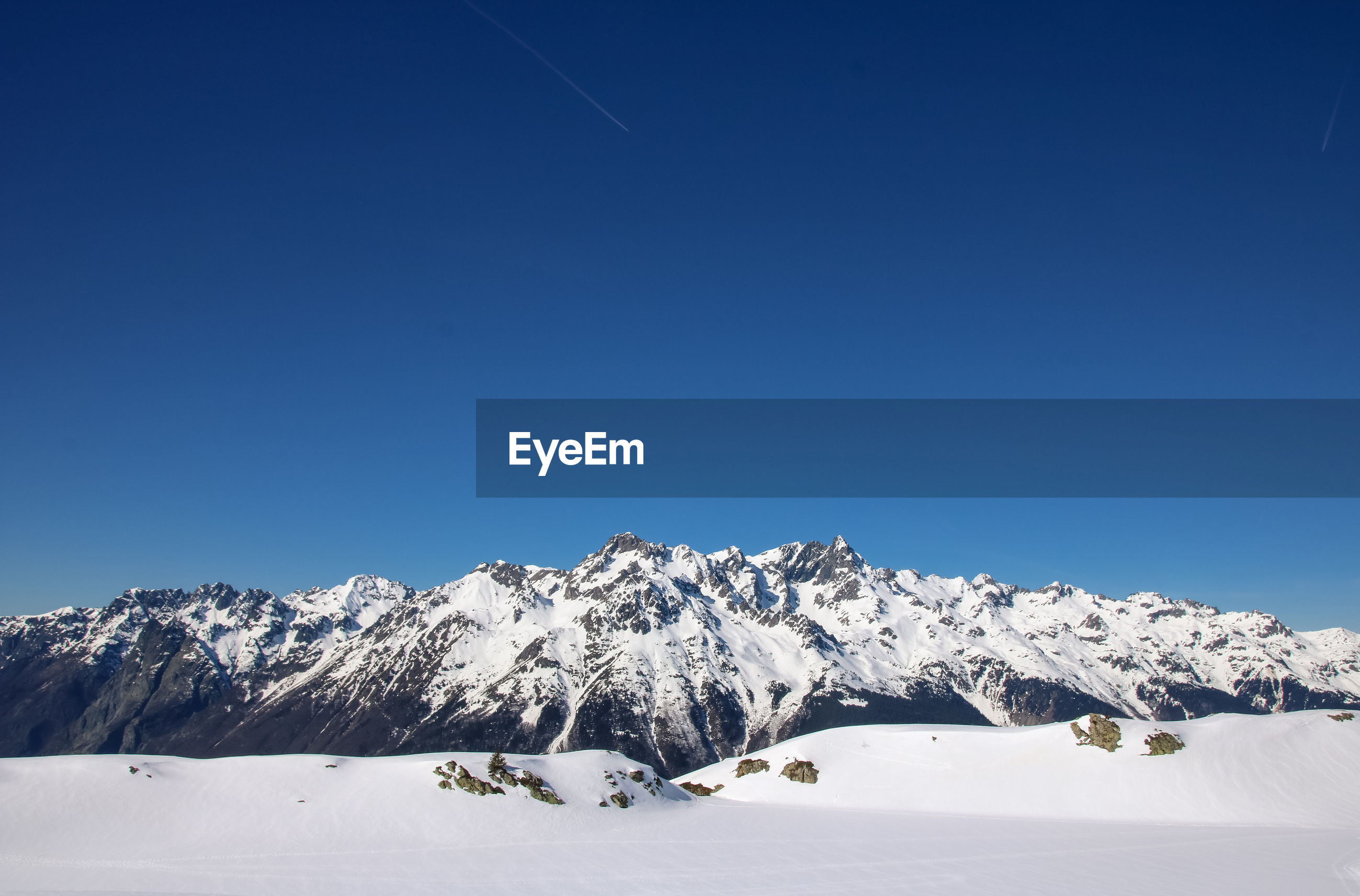 SNOWCAPPED MOUNTAIN AGAINST CLEAR BLUE SKY