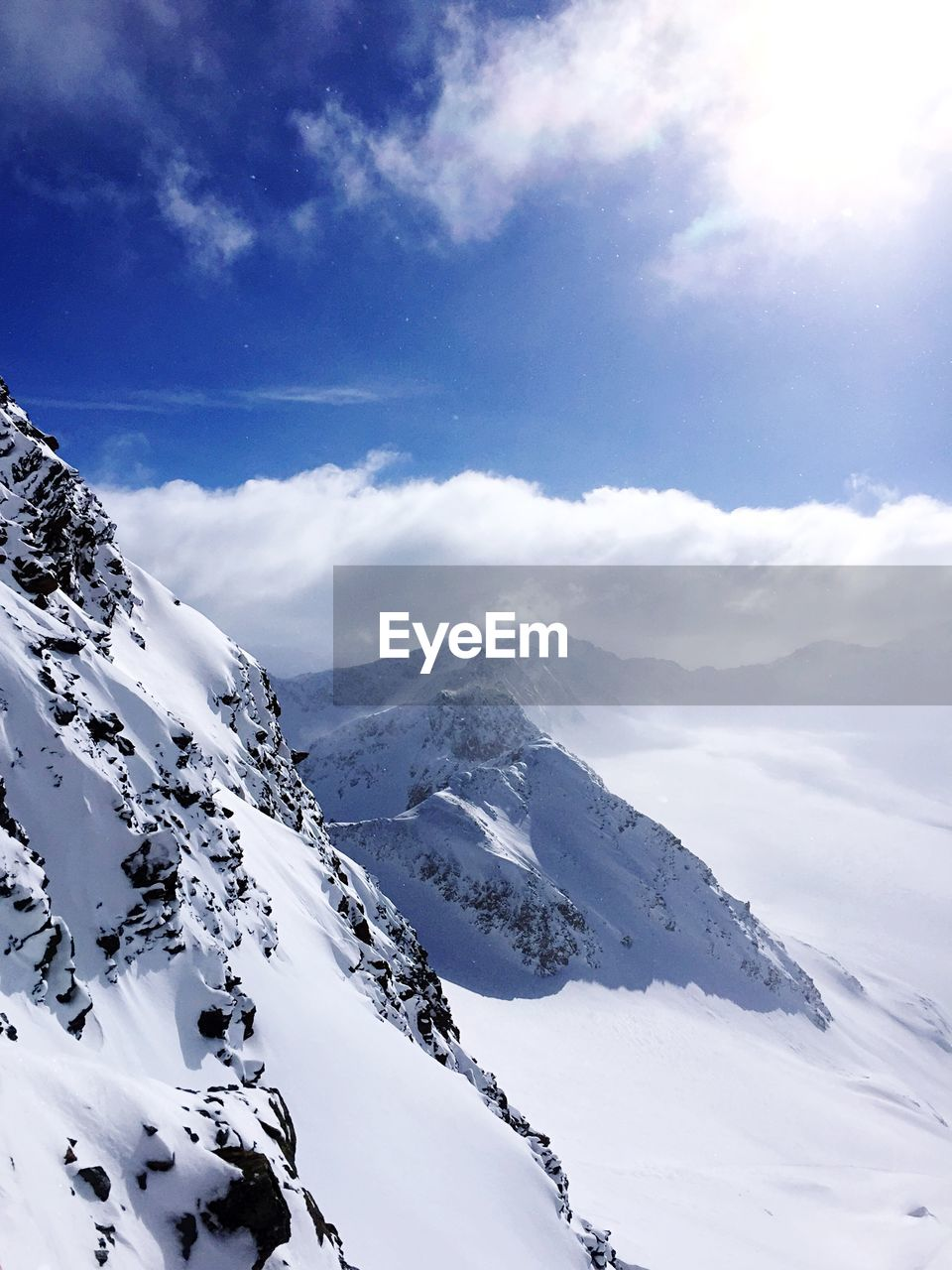 snow, winter, cold temperature, beauty in nature, tranquil scene, tranquility, scenics, nature, mountain, weather, white color, sky, cloud - sky, snowcapped mountain, no people, outdoors, mountain range, day, physical geography, landscape