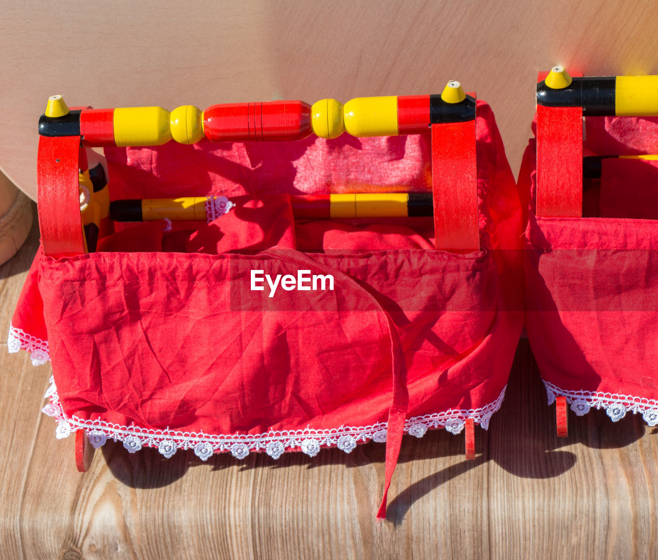 red, no people, indoors, close-up, still life, wood - material, high angle view, textile, hanging, group of objects, multi colored, focus on foreground, vibrant color, choice, variation, shadow, ribbon - sewing item, in a row, clothing, large group of objects