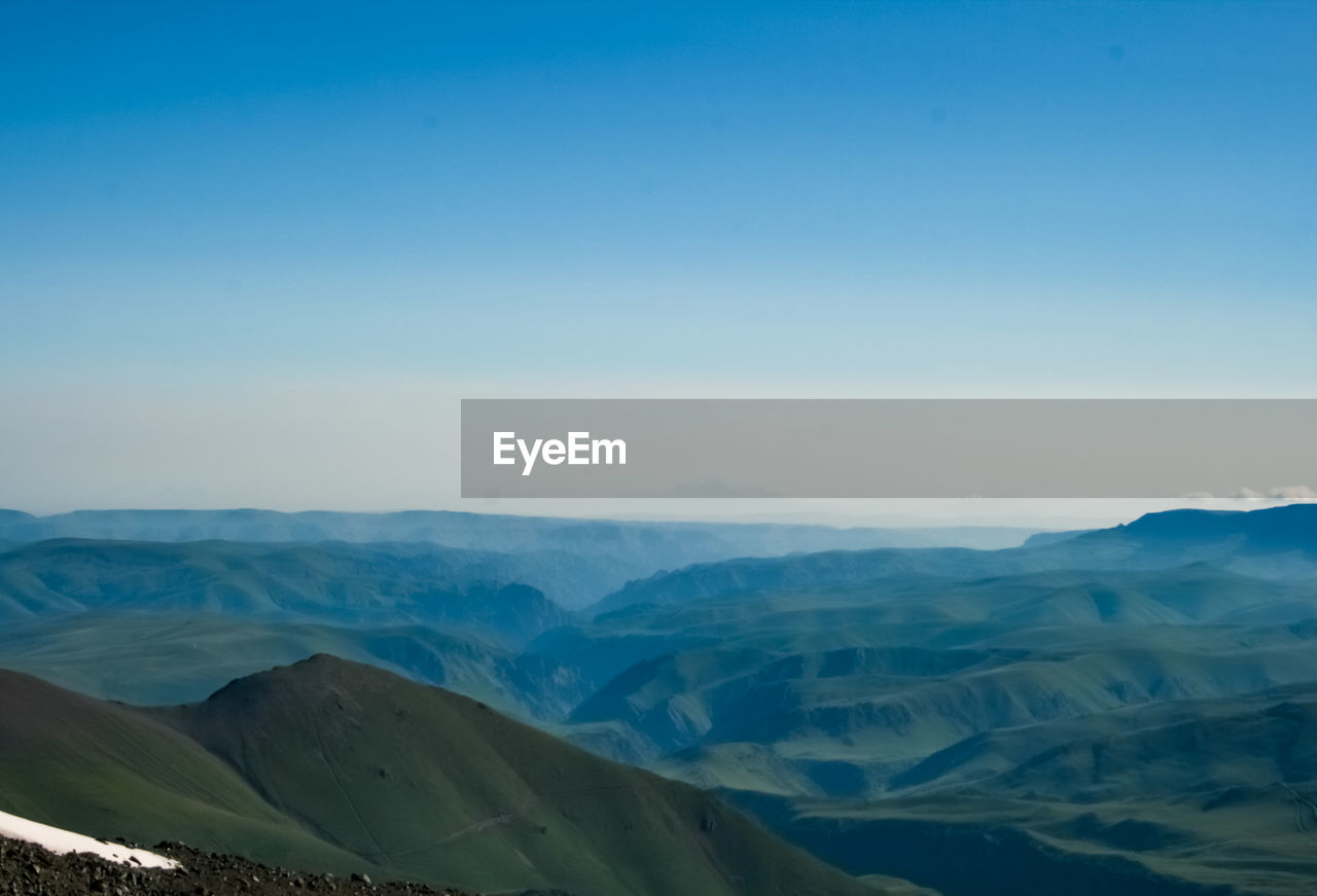 scenics - nature, mountain, beauty in nature, sky, tranquil scene, landscape, tranquility, environment, mountain range, non-urban scene, nature, idyllic, remote, no people, day, copy space, blue, outdoors, clear sky, climate, snowcapped mountain, arid climate, mountain peak