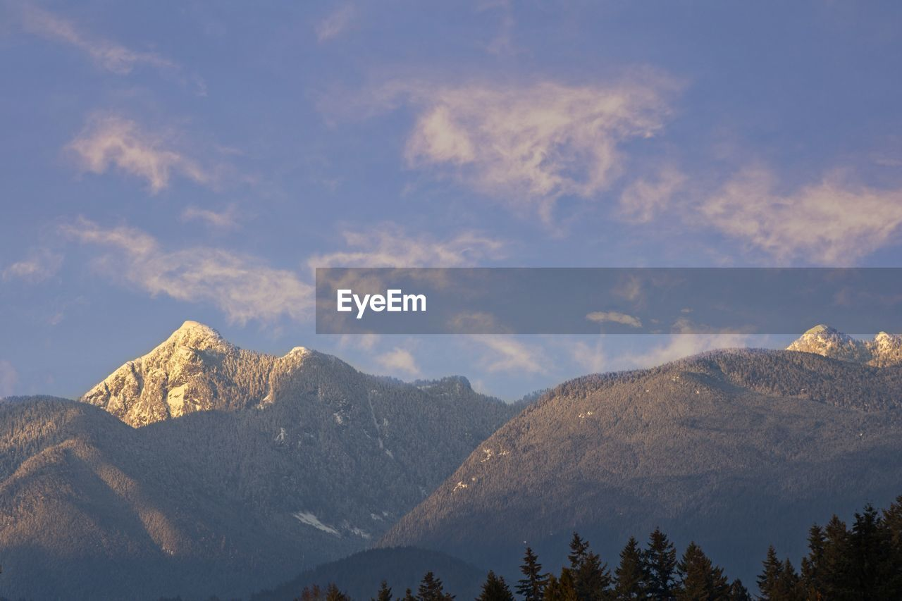 mountain, scenics - nature, beauty in nature, sky, cloud - sky, tranquil scene, tranquility, mountain range, non-urban scene, nature, no people, landscape, idyllic, environment, day, tree, remote, outdoors, cold temperature, mountain peak, snowcapped mountain, range
