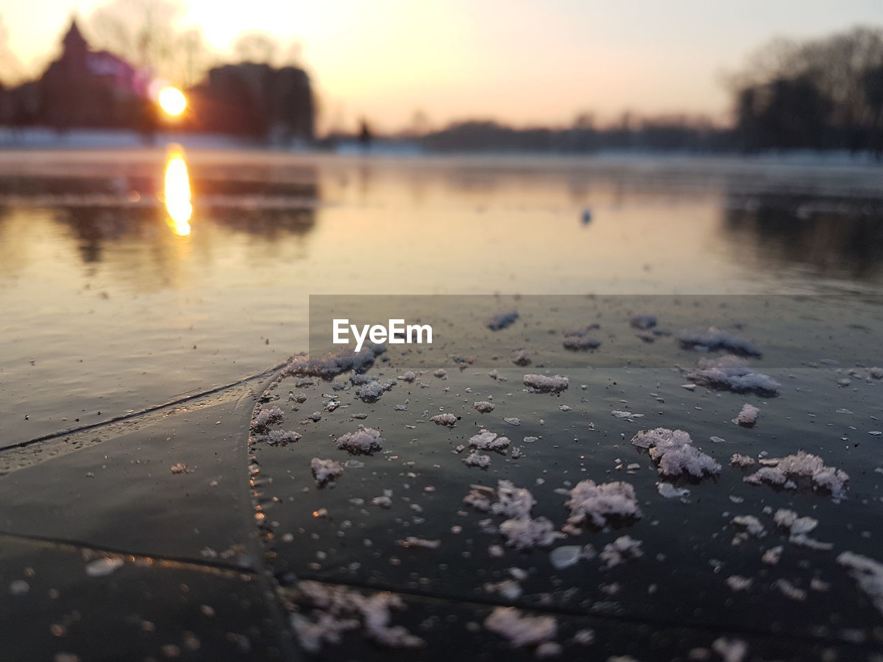 water, sunset, reflection, nature, wet, beauty in nature, no people, tranquility, tranquil scene, outdoors, frozen, sun, drop, lake, scenics, sky, winter, close-up, day