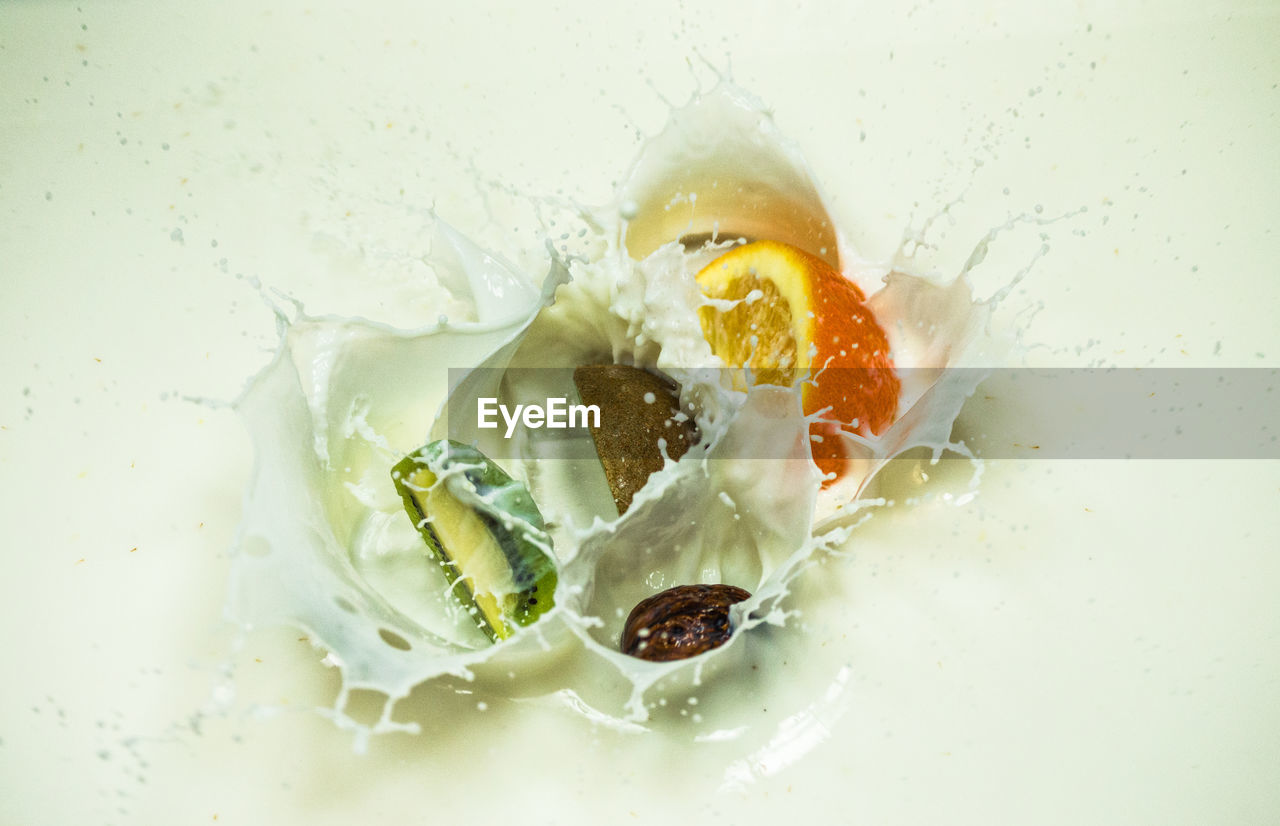 food and drink, food, freshness, indoors, close-up, no people, white color, healthy eating, studio shot, wellbeing, still life, ready-to-eat, indulgence, high angle view, splashing, egg, plate, dairy product, directly above, temptation