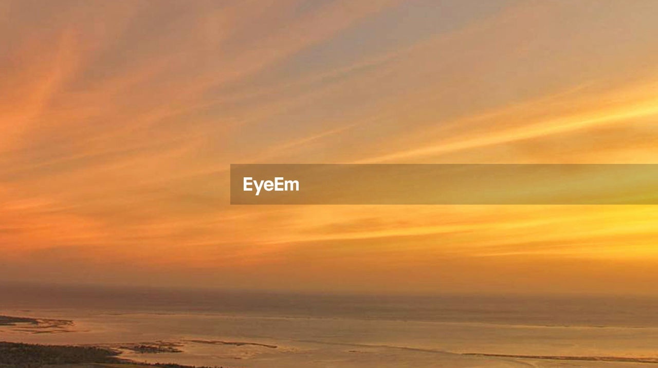 sky, sunset, sea, cloud - sky, scenics - nature, water, beauty in nature, tranquility, horizon, horizon over water, tranquil scene, dramatic sky, nature, land, orange color, beach, no people, landscape, outdoors, romantic sky
