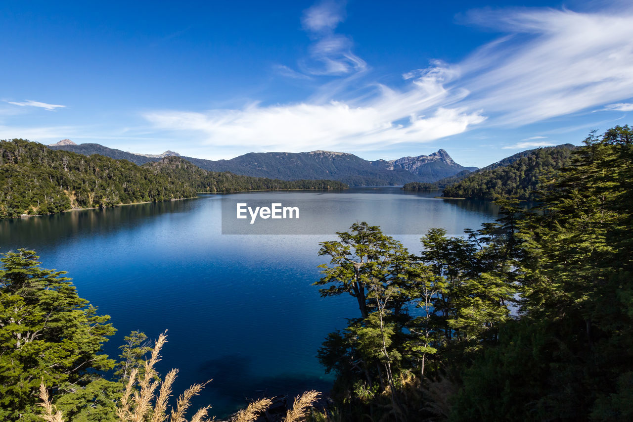 water, scenics - nature, beauty in nature, tranquil scene, tranquility, tree, sky, mountain, plant, lake, cloud - sky, non-urban scene, nature, blue, idyllic, day, no people, mountain range, reflection, outdoors