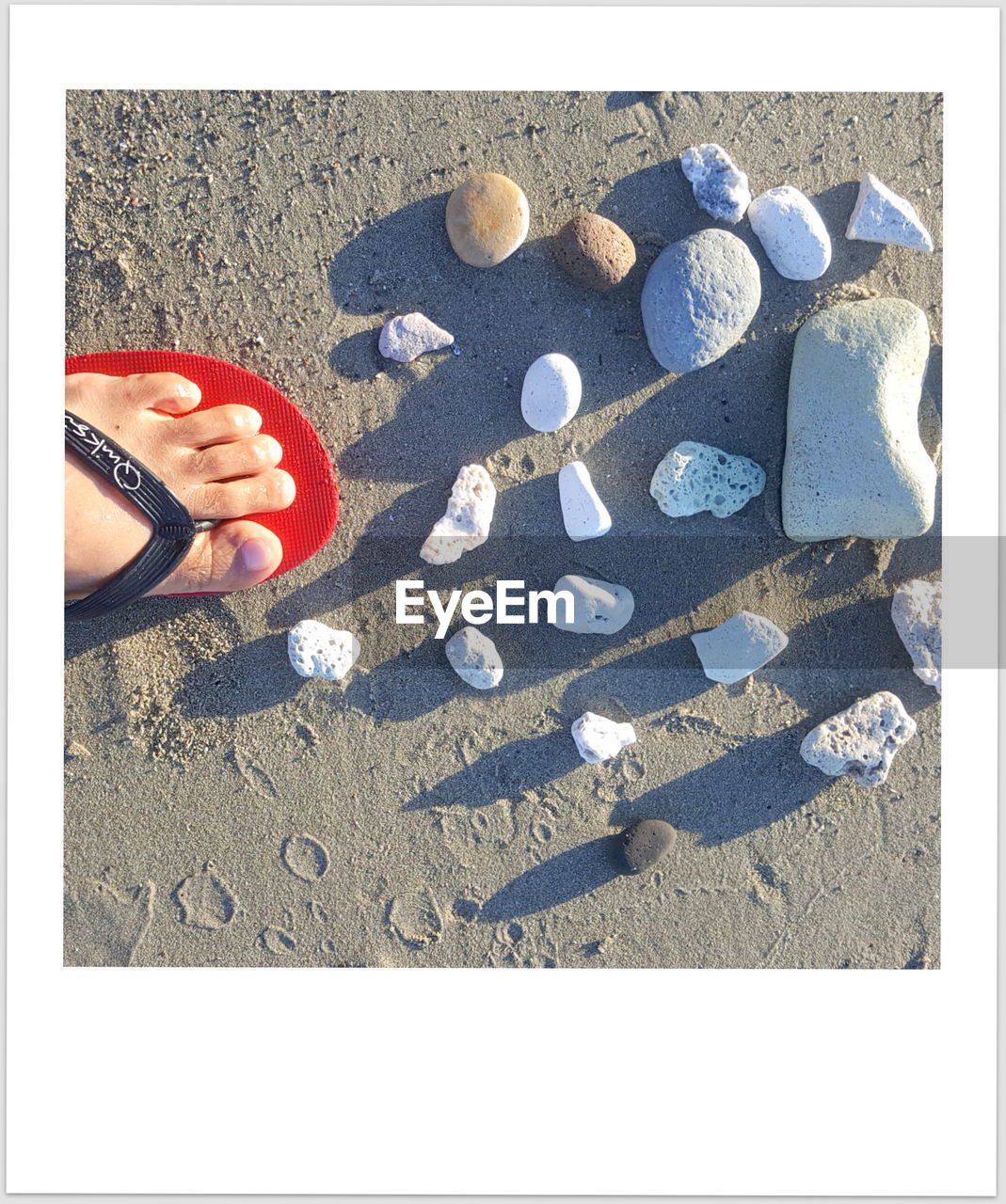 sand, human body part, beach, human hand, day, outdoors, human leg, real people, one person, sunlight, low section, childhood, nail polish, people
