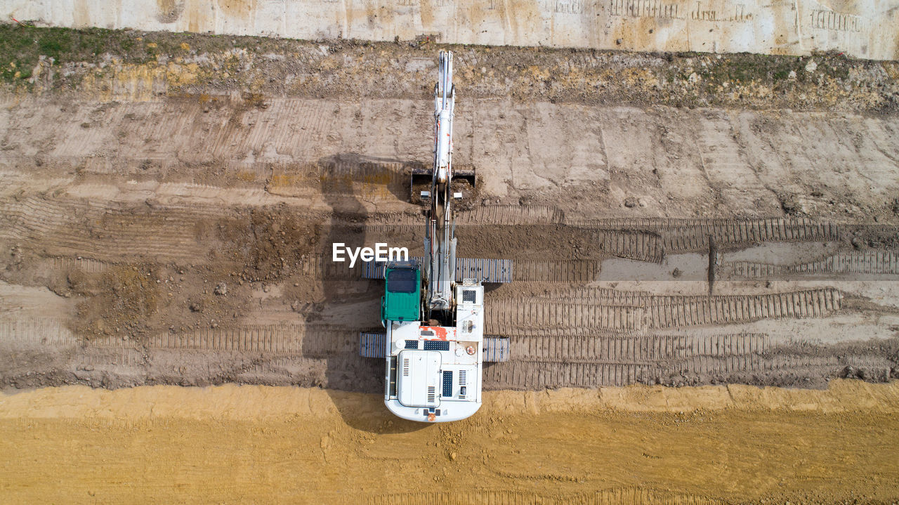 Aerial view of construction machinery on landscape