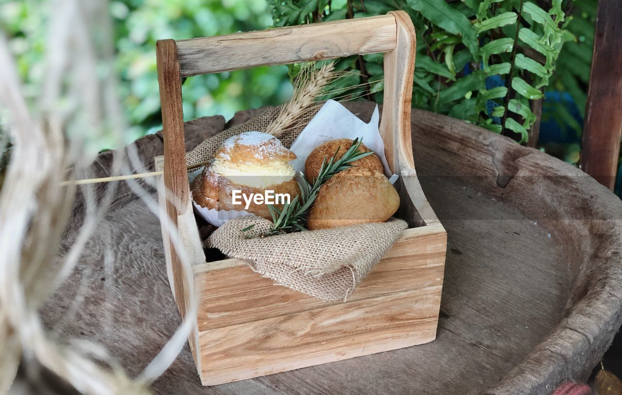 food and drink, basket, food, freshness, container, wood - material, no people, bread, healthy eating, table, wicker, wellbeing, still life, close-up, high angle view, day, leaf, plant, selective focus, outdoors, tray