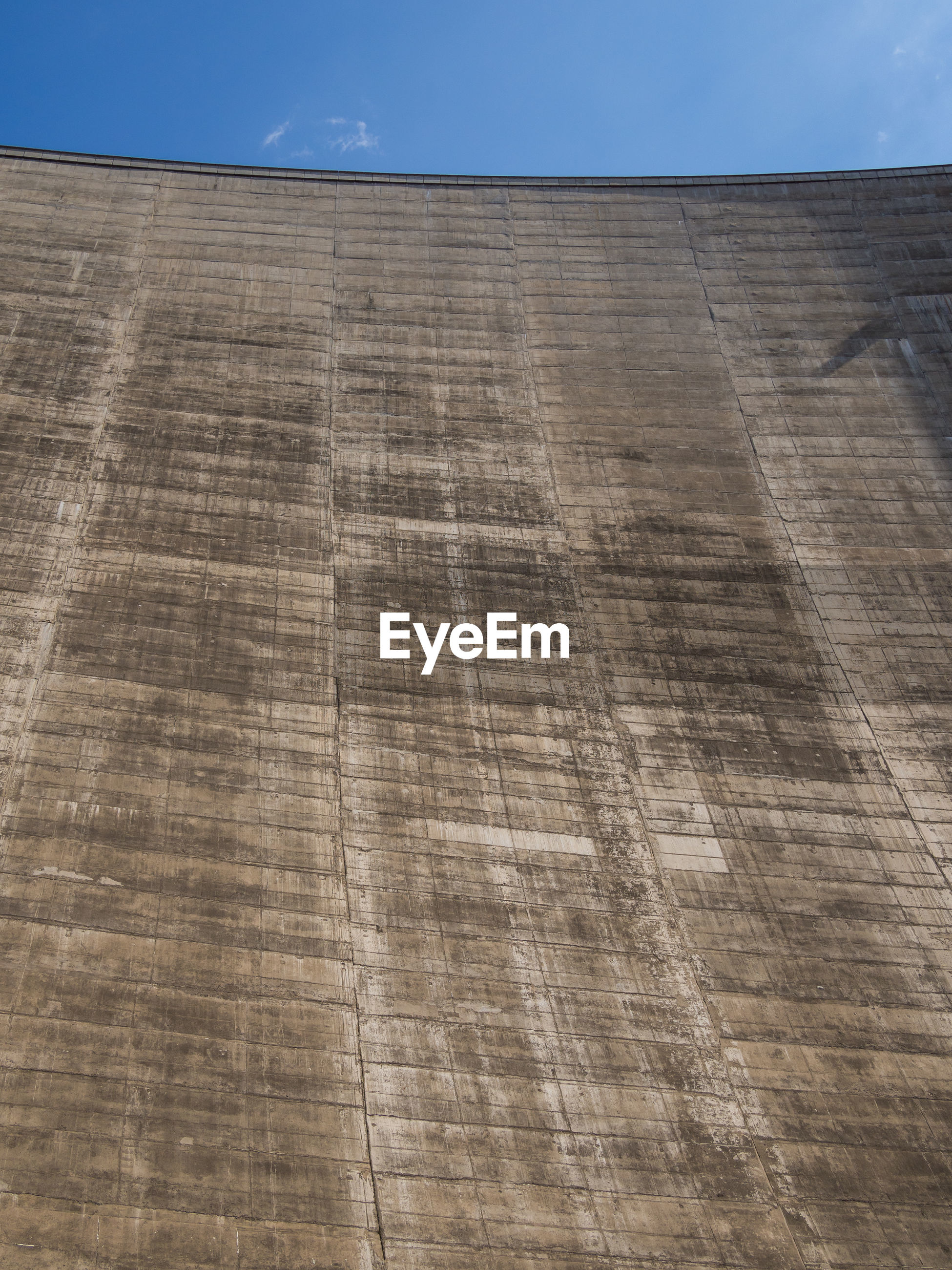 Low angle view of concrete katse dam wall, lesotho, africa