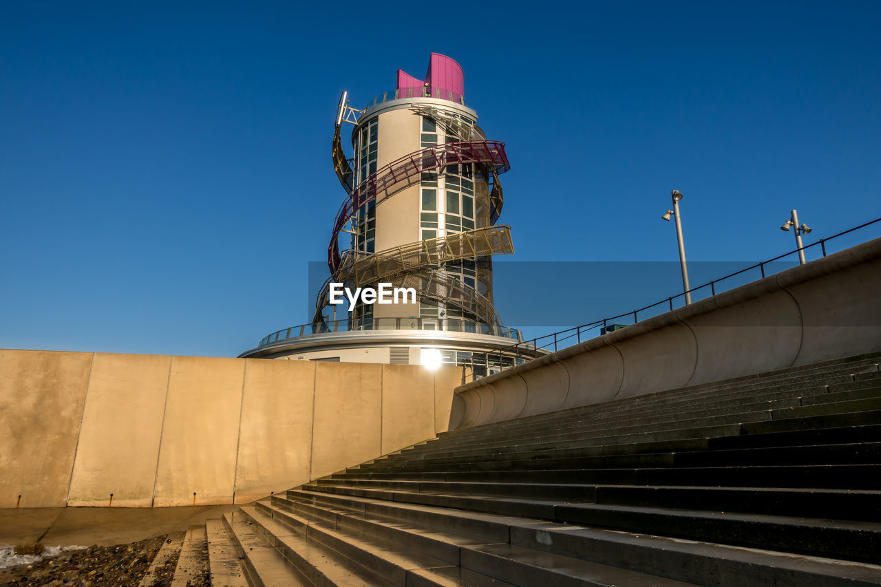 architecture, sky, built structure, blue, building exterior, clear sky, nature, no people, low angle view, staircase, direction, day, outdoors, railing, sunlight, industry, technology, travel destinations, fuel and power generation, tower