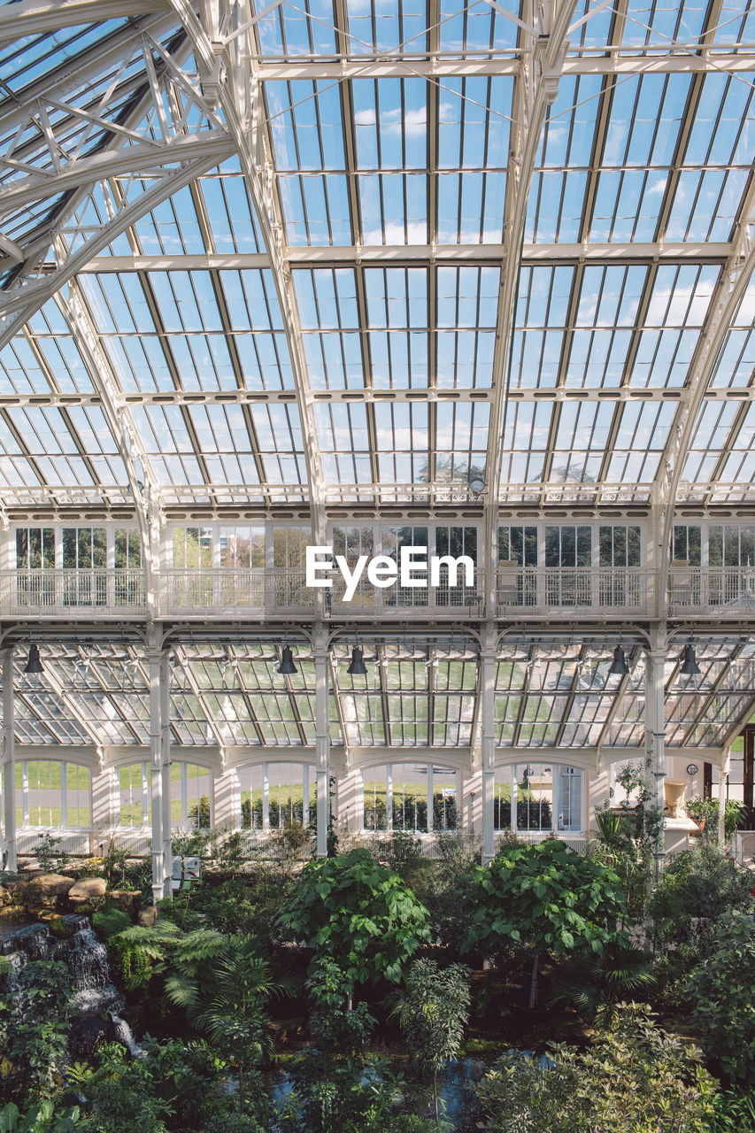 plant, built structure, day, architecture, growth, nature, indoors, no people, greenhouse, tree, botany, plant nursery, glass - material, agriculture, building, beauty in nature, green color, roof, ceiling, gardening