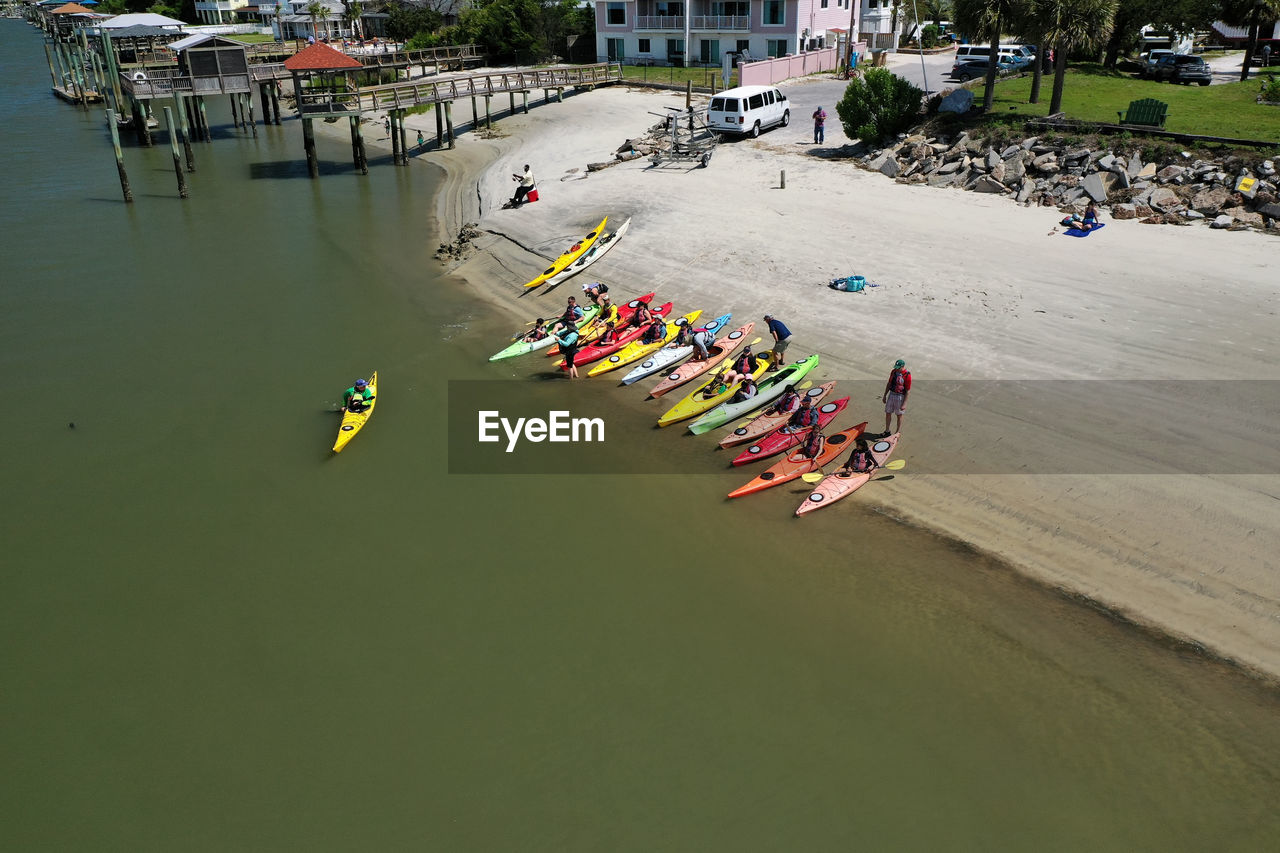 water, crowd, transportation, group of people, nautical vessel, high angle view, mode of transportation, large group of people, real people, nature, day, men, waterfront, lifestyles, women, leisure activity, sea, travel
