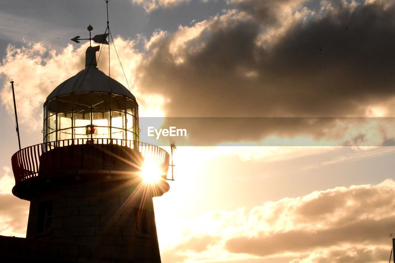 sky, cloud - sky, sunset, sunlight, architecture, built structure, sun, nature, low angle view, orange color, lens flare, tower, building exterior, sunbeam, beauty in nature, silhouette, outdoors, no people, scenics - nature, guidance