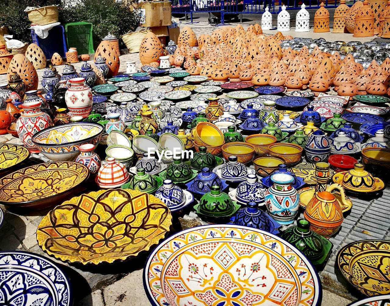 choice, variation, large group of objects, for sale, retail, abundance, market, arrangement, market stall, multi colored, art and craft, no people, pattern, collection, retail display, small business, high angle view, ceramics, day, sale, order, outdoors